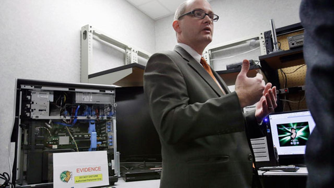 FILE: FBI supervisory Special Agent Ronald E. Menold II stands in the New Jersey Regional Computer Forensics Laboratory Wednesday, Feb. 27, 2013, in Hamilton Township, N.J.