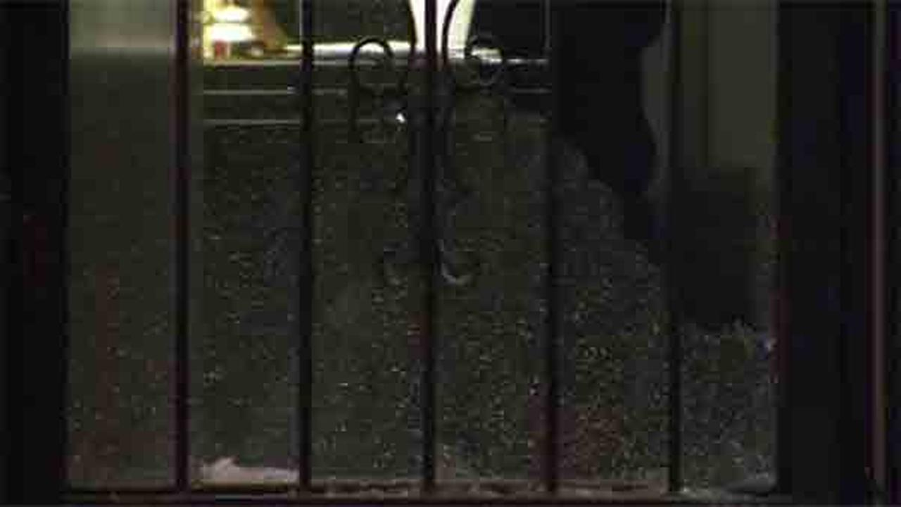 Police are trying to determine who opened fired after a stray bullet struck a womans front door in Philadelphias Frankford section.