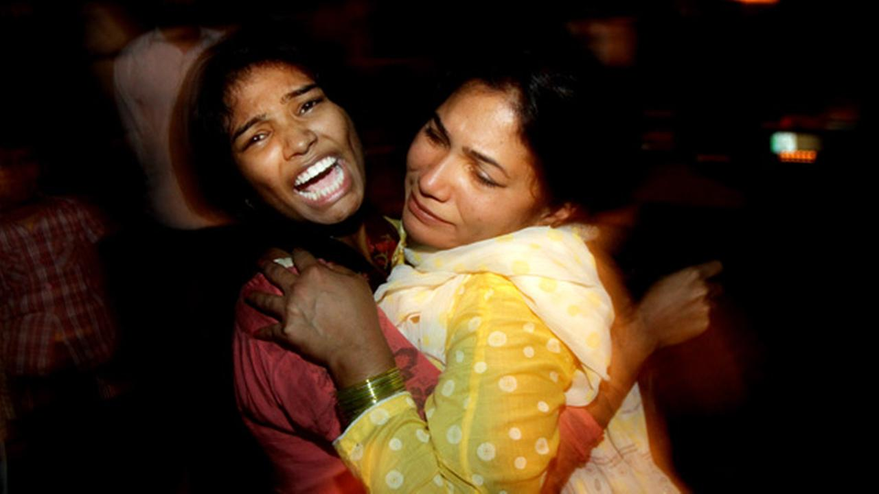 Women comfort each other as they mourn over the death of a family member who was killed in a bomb blast, at a local hospital in Lahore, Pakistan, Sunday, March, 27, 2016.
