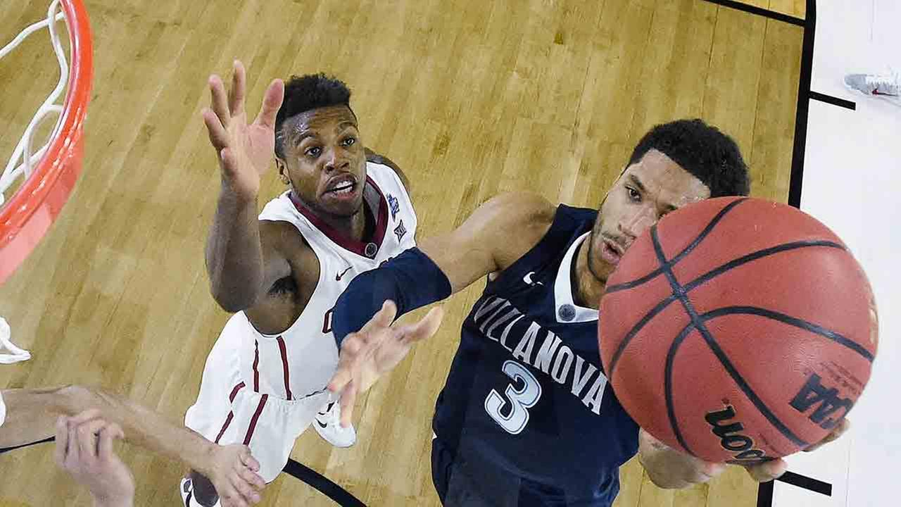 Villanova guard Josh Hart (3) shoots against Oklahoma center Jamuni McNeace during the second half of the NCAA Final Four tournament college basketball semifinal game.