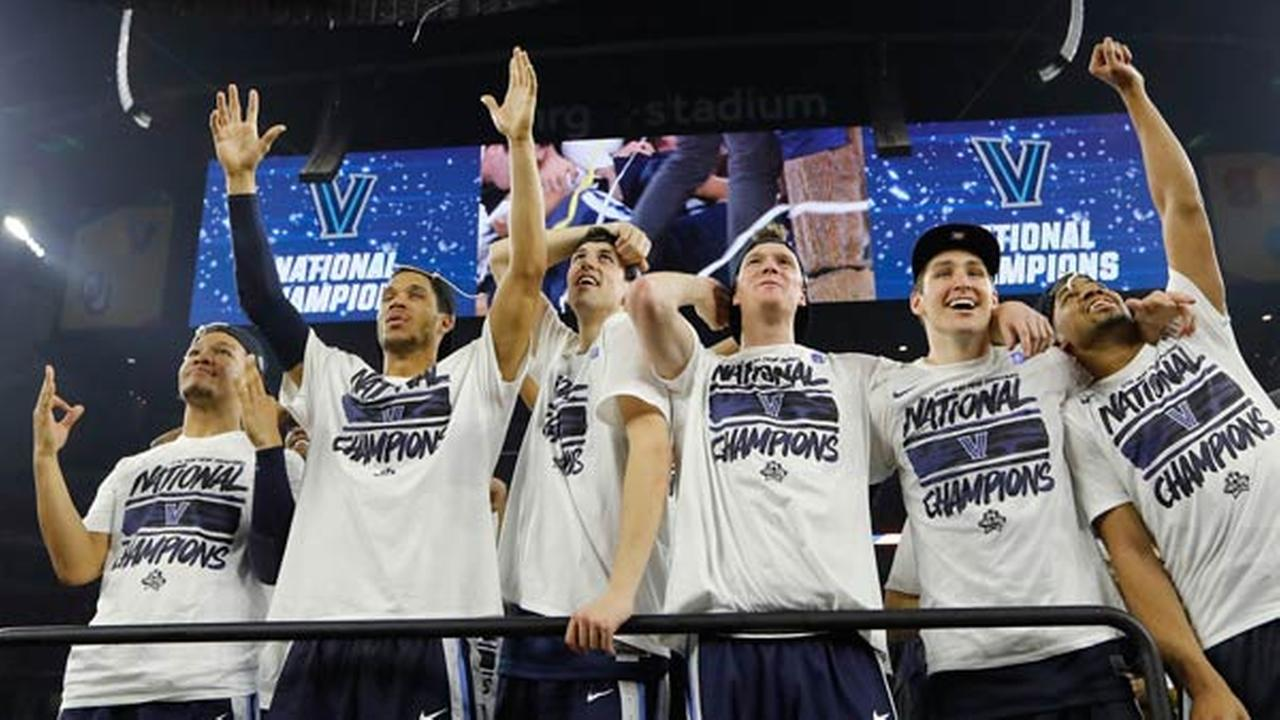Villanova players celebrate on the court after the NCAA Final Four tournament college basketball championship game against North Carolina.
