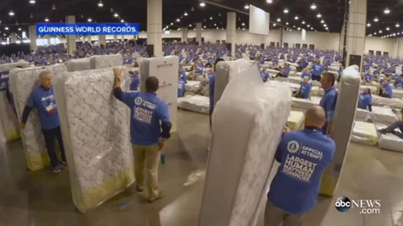 Record for longest human mattress dominoes chain topples