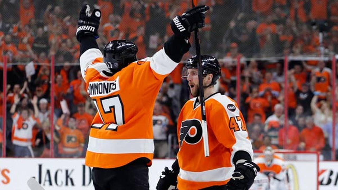 Philadelphia Flyers Wayne Simmonds, left, and Andrew MacDonald celebrate after MacDonalds goal during the second period of Game 4.