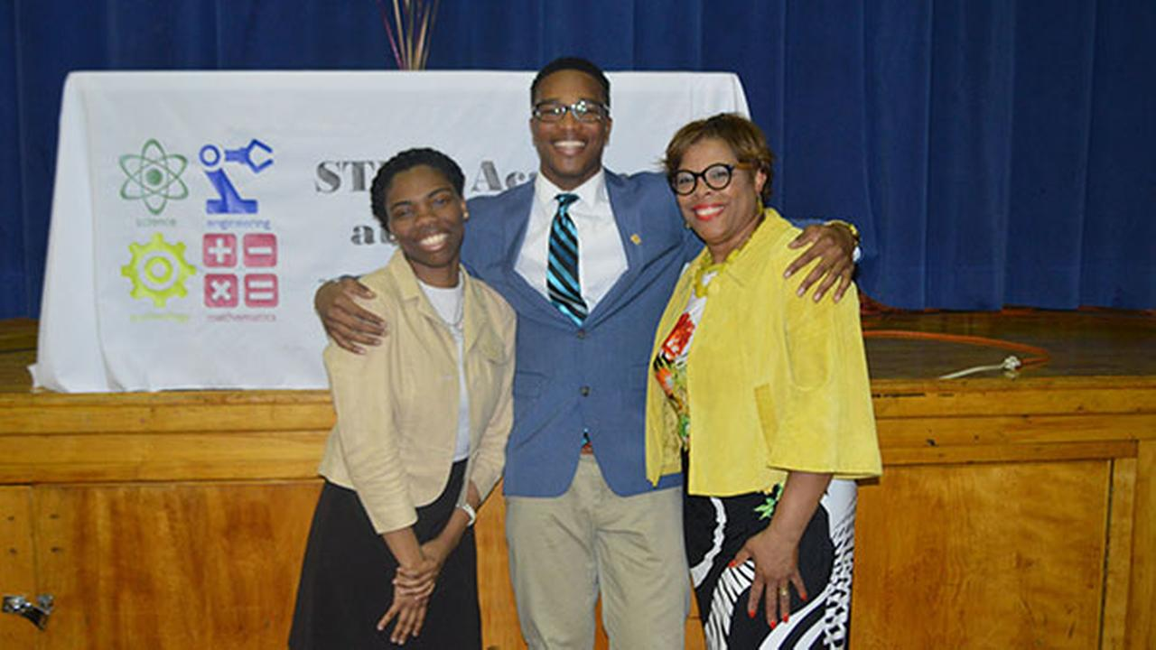 Chester Upland School District seniors Autumn Bey and Edward Nelson Jr. celebrate their selection as Gates Millennium Scholars with Chief of Staff Claudia Averette at STEM Academy.