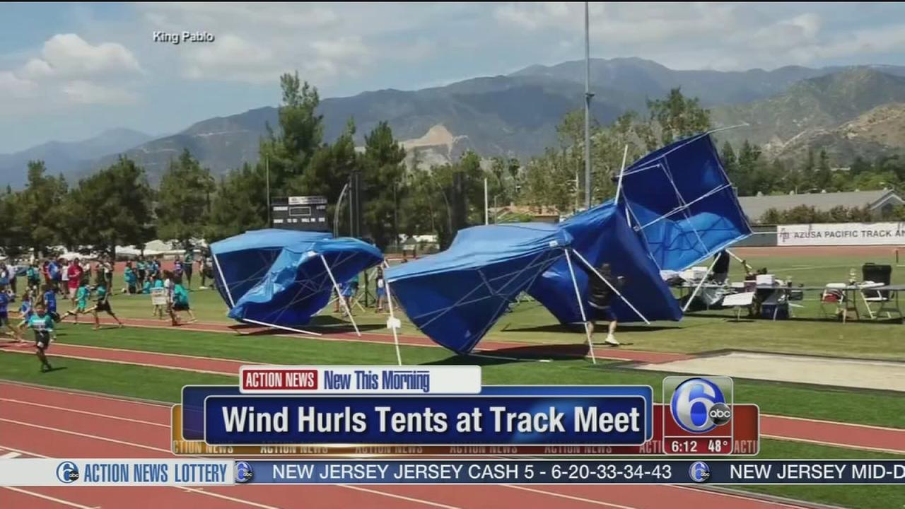 VIDEO: Wind hurls tents at track meet