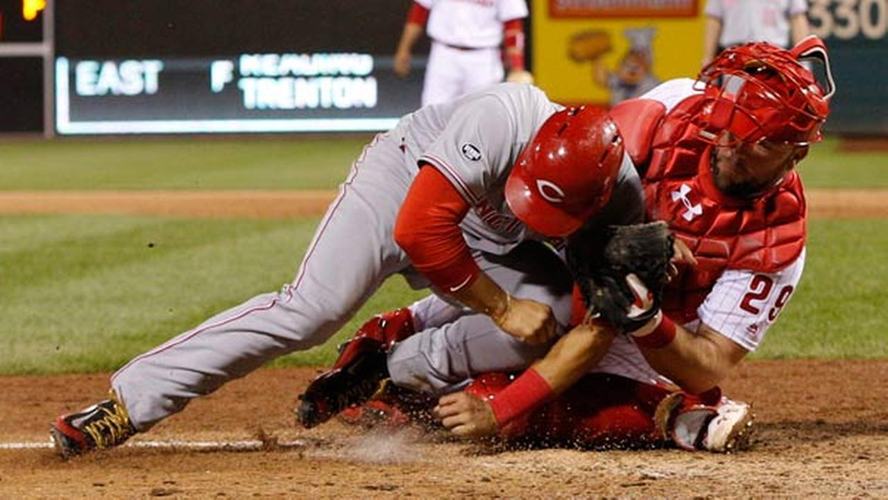 Philadelphia Phillies catcher Cameron Rupp, right, tags out Cincinnati Reds Eugenio Suarez, left, on the double play to end the ninth inning of a baseball game, Saturday, May 14,