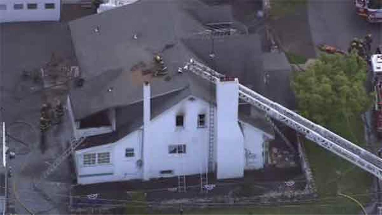 An 86-year-old woman is hospitalized after a house fire in Northeast Philadelphia.