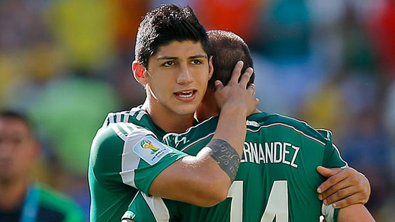 FILE - In a June 29, 2014 file photo, Mexicos Alan Pulido consoles teammate Javier Hernandez (14) after the Netherlands defeated Mexico 2-1 during the World Cup round of 16 match.