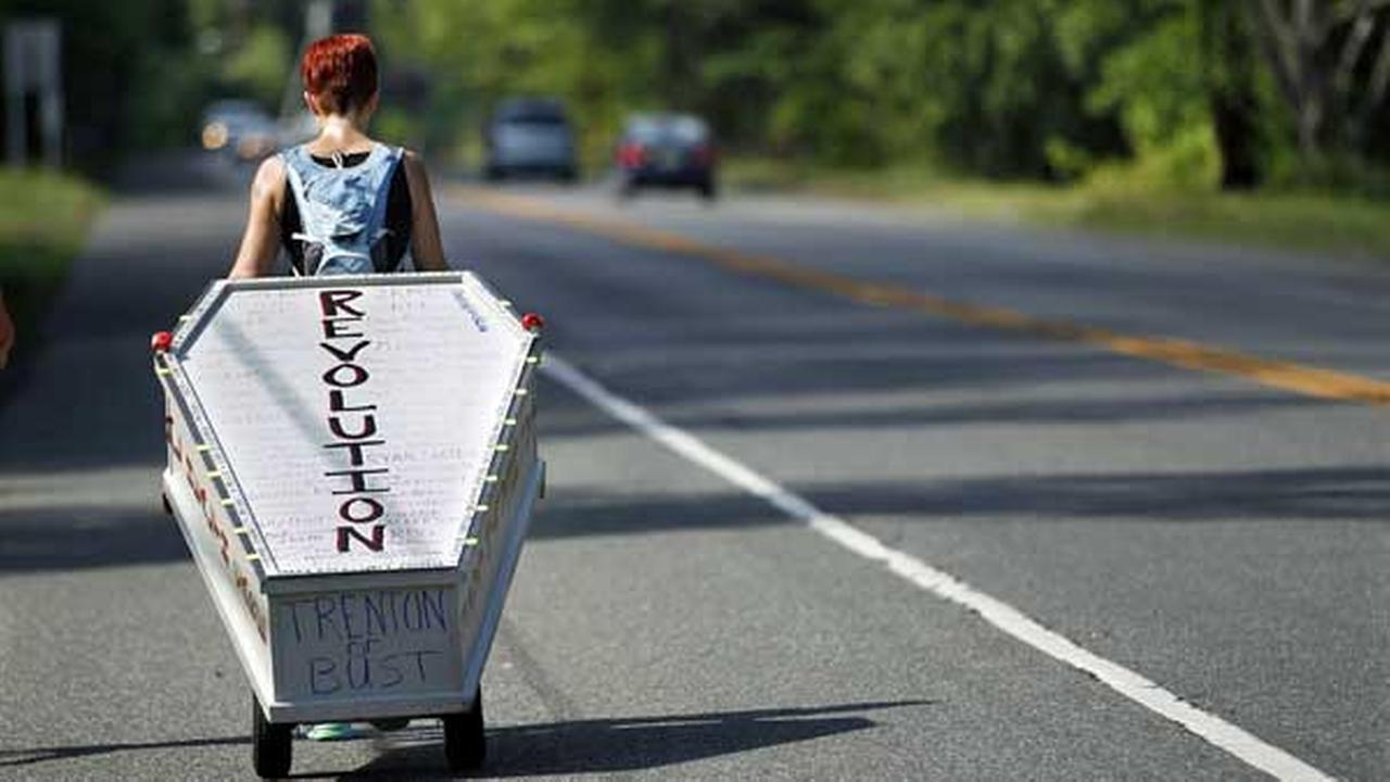 Greta Schwartz, of Seaville, N.J., pulls a casket as she walks along route 206, from southern New Jersey to Trenton Tuesday, May 31, 2016.
