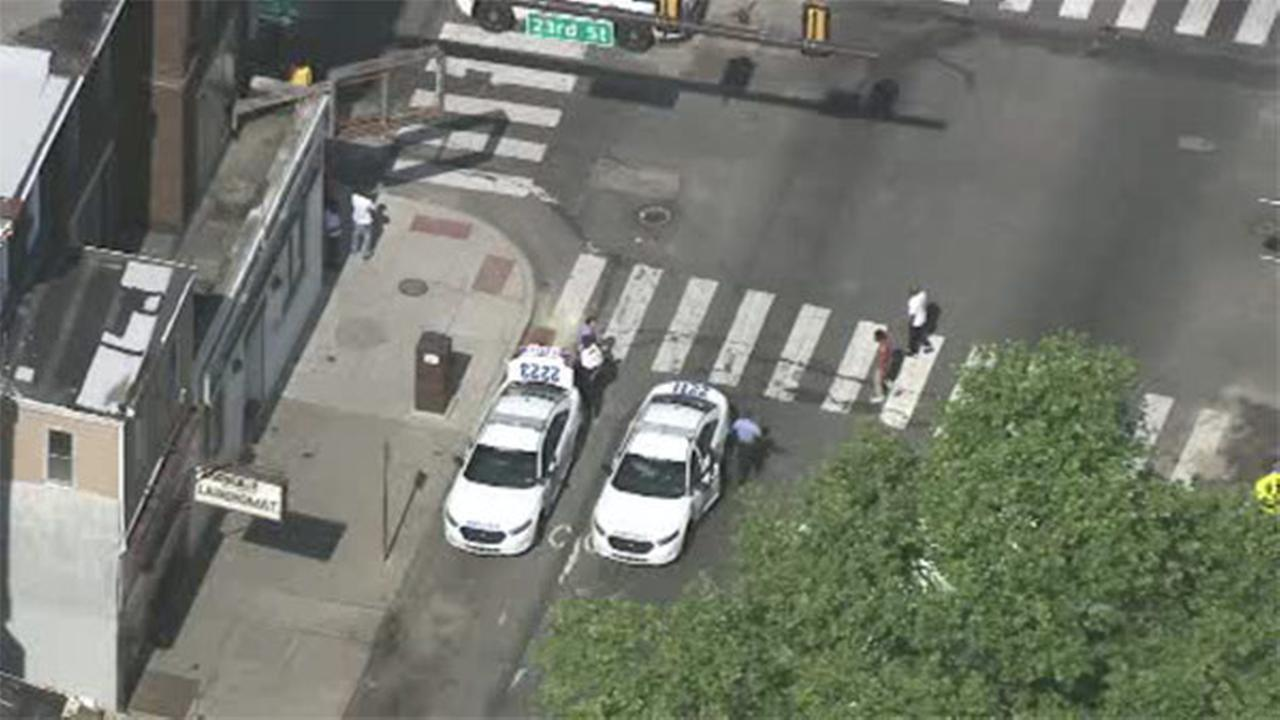 Police: Male in custody after attempting to steal Philadelphia officer's gun