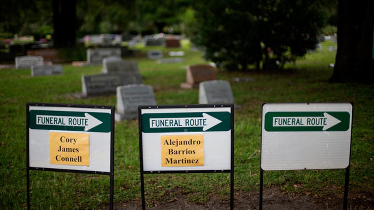 Signs point the way for funeral processions for victims of the Orlando mass shooting. It is not clear whose funeral procession was taking place when the crash occurred.