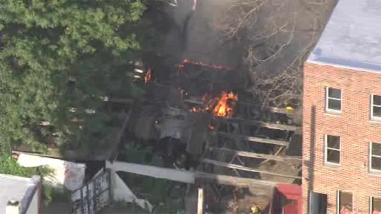 A fire destroyed a garage in the Kensington section of Philadelphia.