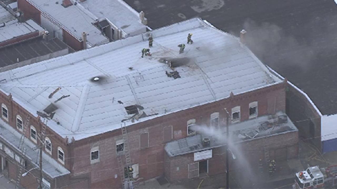 Fire crews battled a two-alarm fire at a building in the Frankford section of Philadelphia.