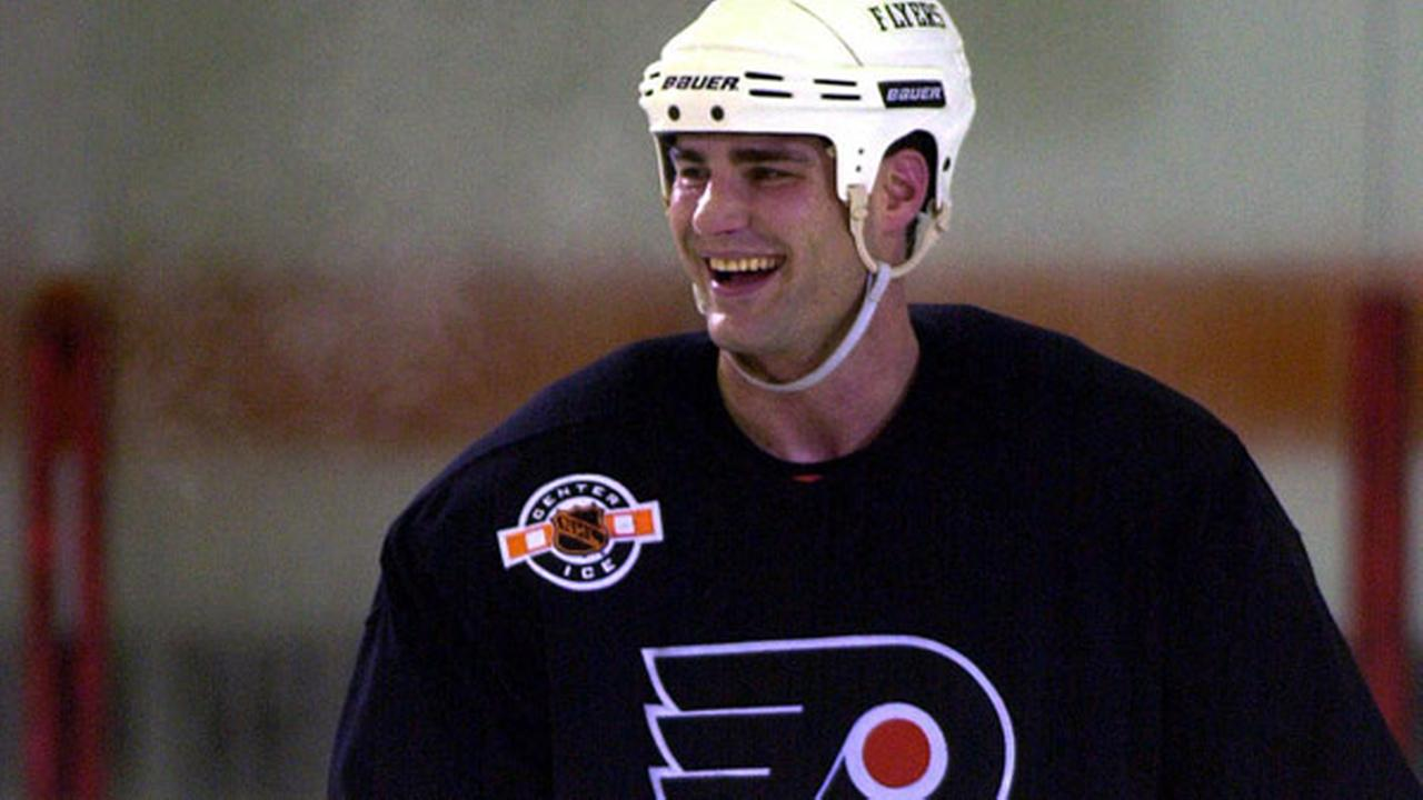 FILE - In this May 23, 2000, file photo, Philadelphia Flyers Eric Lindros smiles during practice, in Voorhees, N.J.