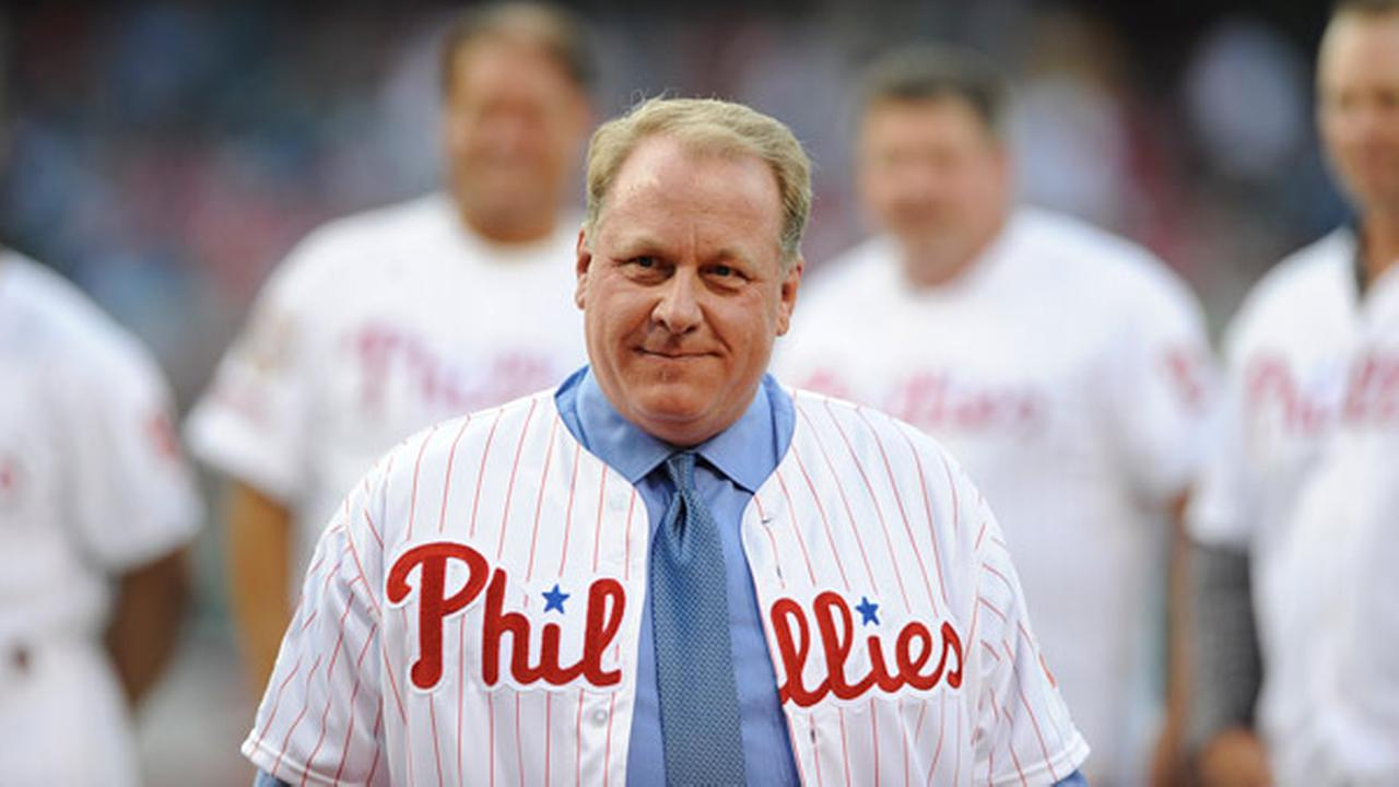 FILE - In an Aug. 2, 2013 file photo, former Philadelphia Phillies pitcher Curt Schilling is inducted into the Phillies Wall of Fame during a baseball game.