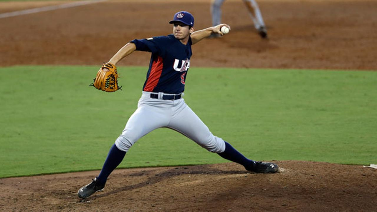 United States Matt Imhof pitches against Cuba duringan exhibition baseball game in Cary, N.C., Monday, July 22, 2013. (AP Photo/Gerry Broome)
