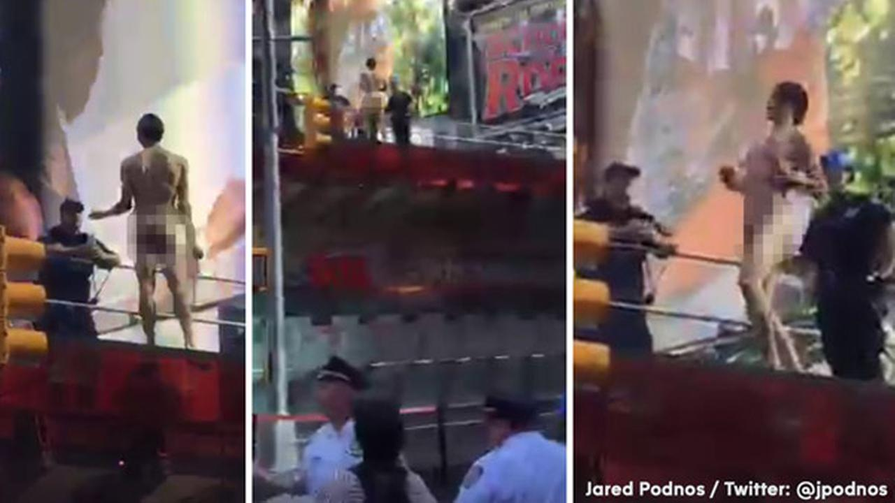 Naked, emotionally disturbed man stands off with NYPD atop TKTS booth in Times Square