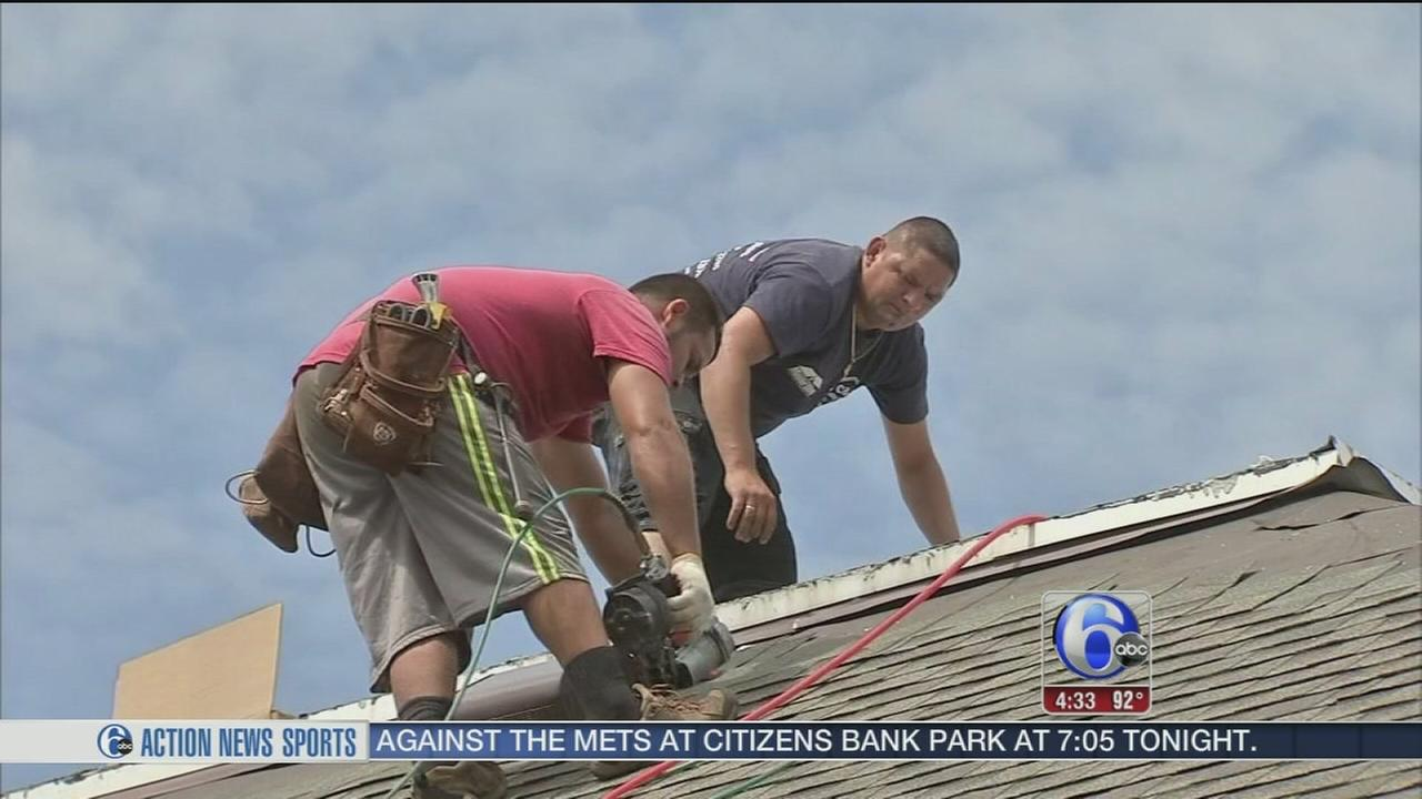 VIDEO: Roofers keep busy, stay cool in extreme heat