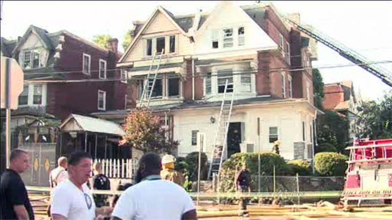 Four people rescued after fire in Logan