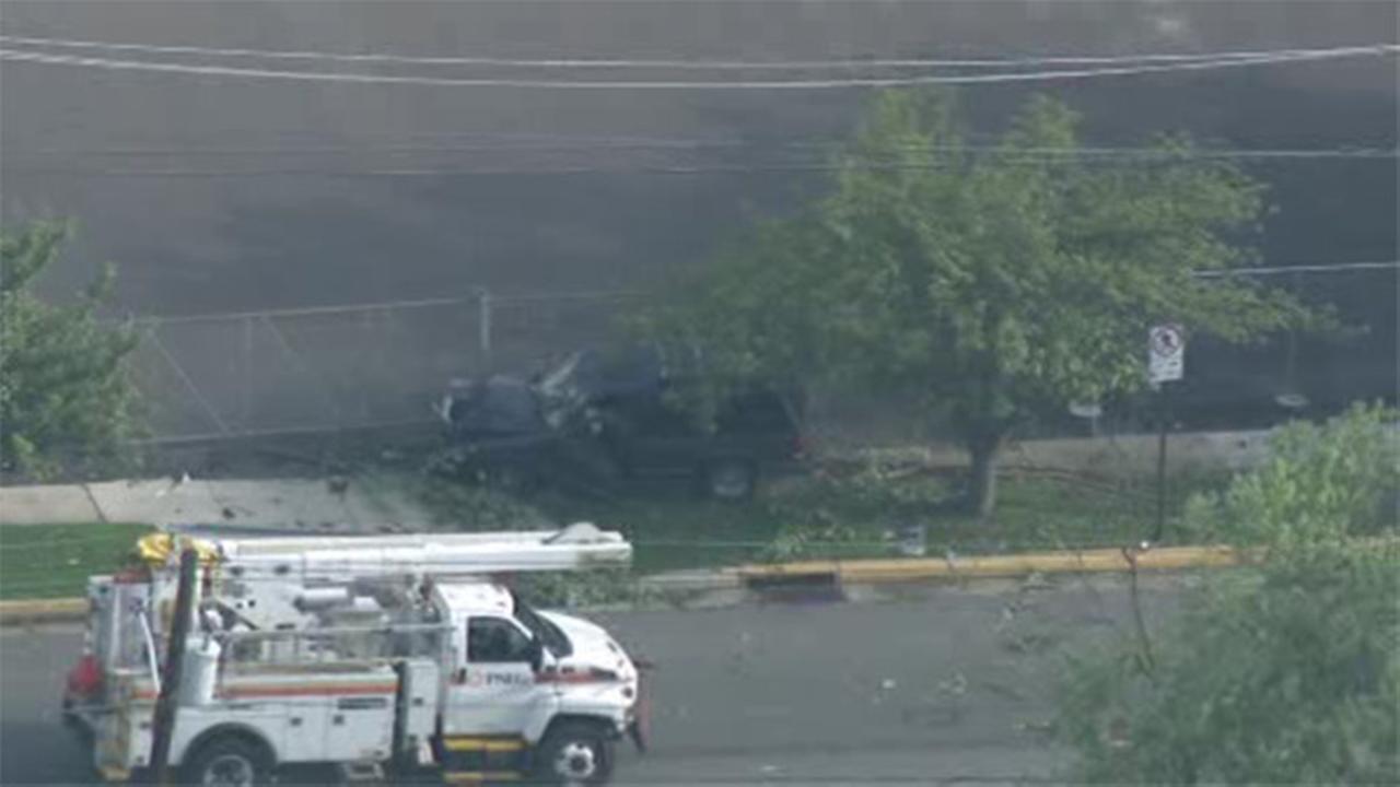Car crashes into utility pole in Burlington; power restored