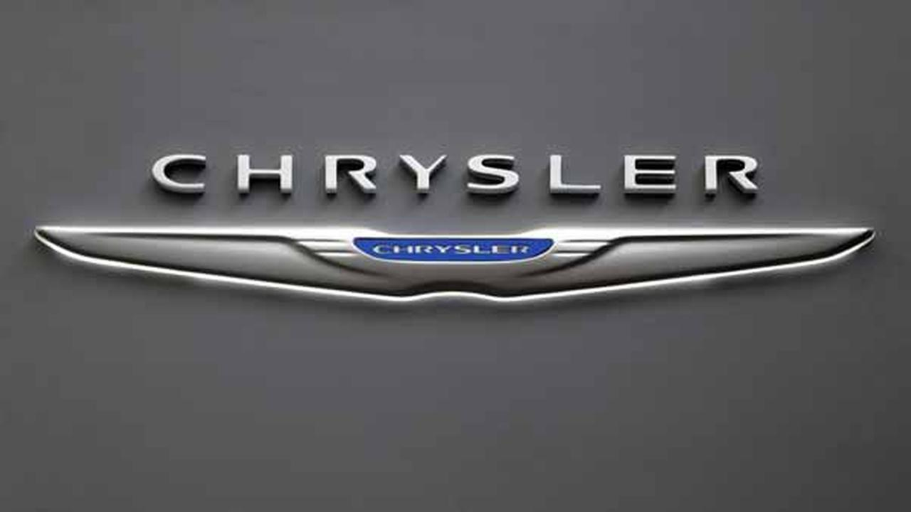 This Photo taken Feb. 14, 2013 shows the Chrysler logo on a sign at the 2013 Pittsburgh Auto Show in Pittsburgh. (AP Photo/Gene J. Puskar)