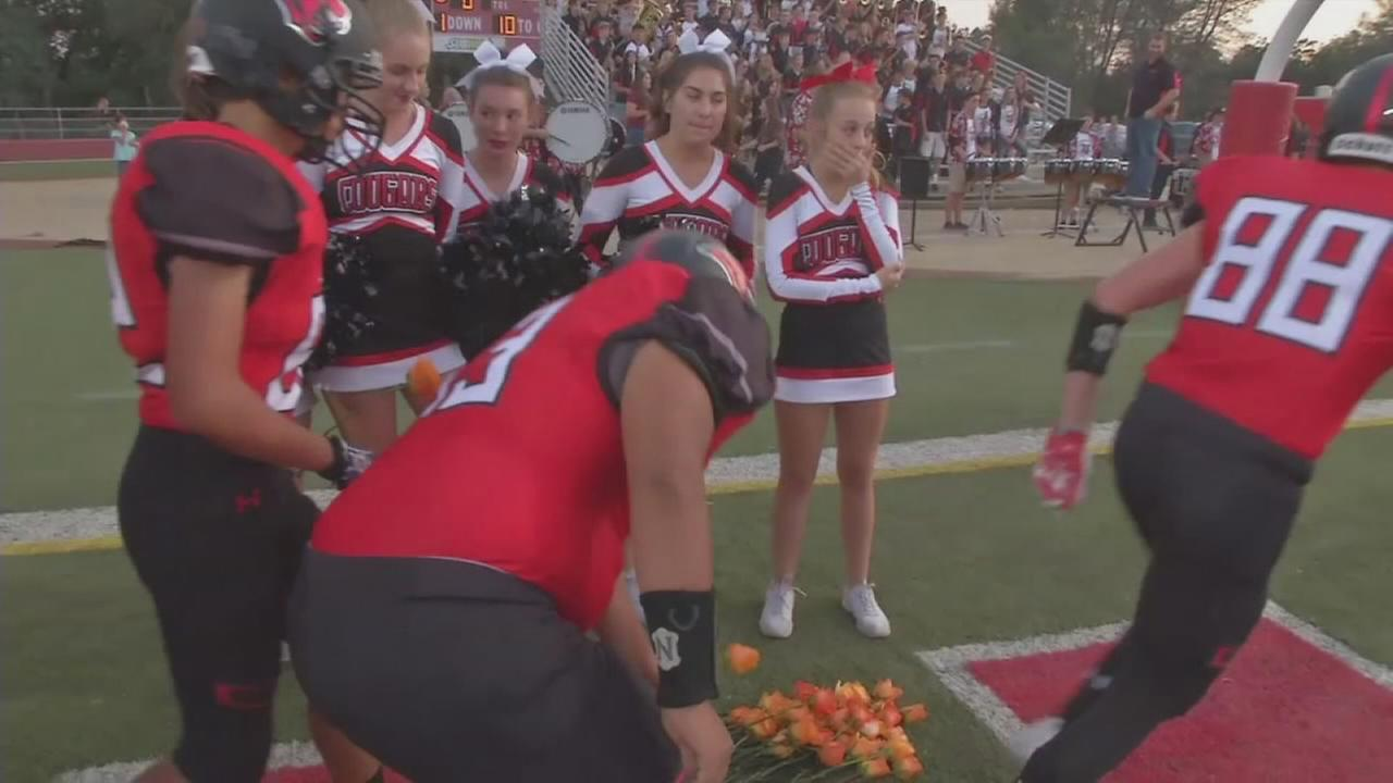 VIDEO: Football team pays touching tribute to cheerleader with leukemia