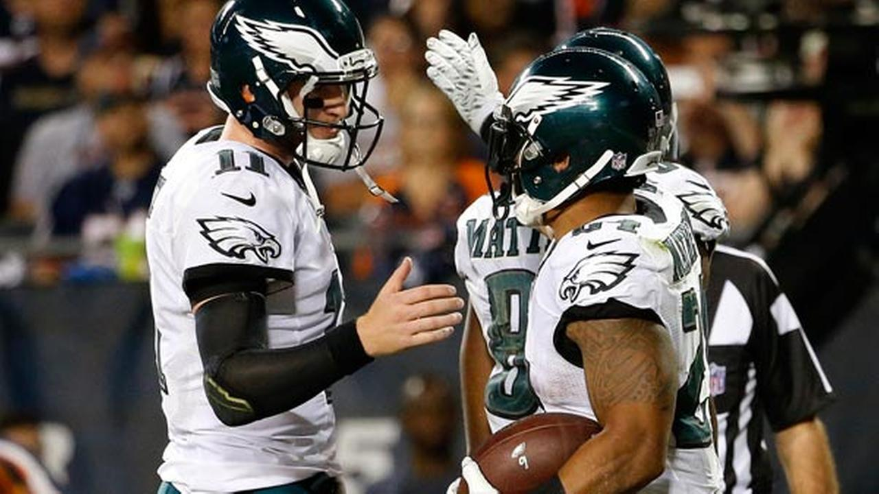 Philadelphia Eagles quarterback Carson Wentz (11) celebrates a touchdown with Philadelphia Eagles running back Ryan Mathews (24)during the second half of an NFL football game.
