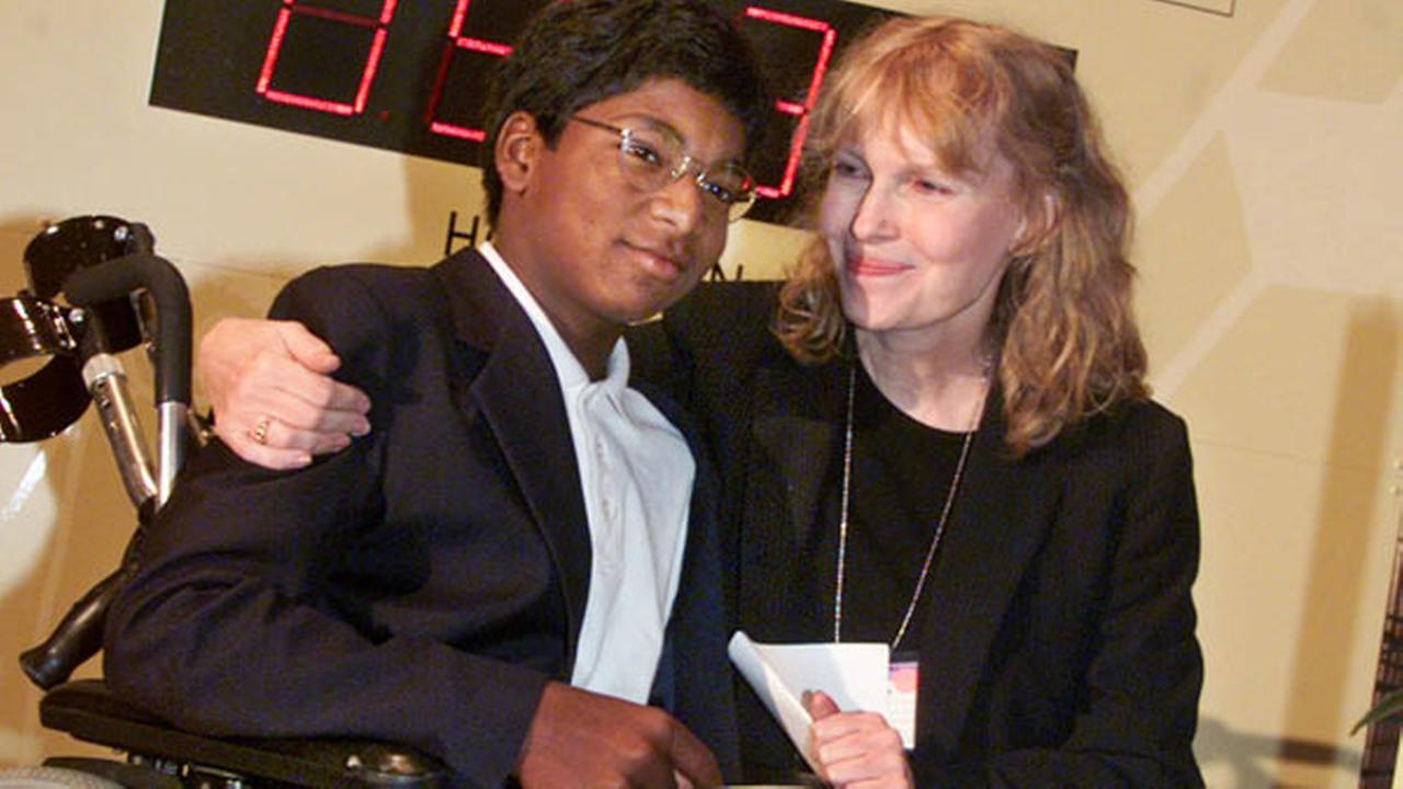 FILE: Actress Mia Farrow puts her arm around her adopted son Thaddeus as they participate in the global summit on polio eradication Wednesday, Sept. 27, 2000.