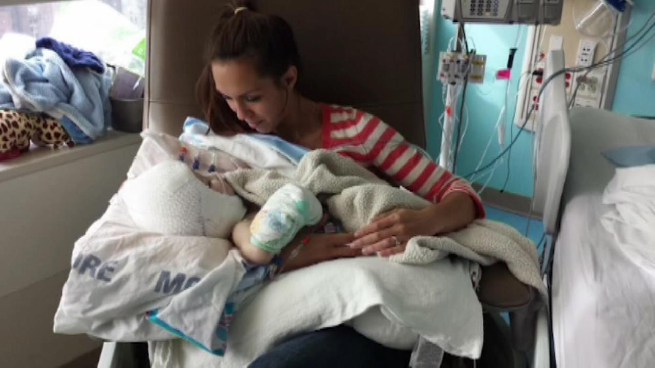 mother of separated conjoined twins holds son alone for the first