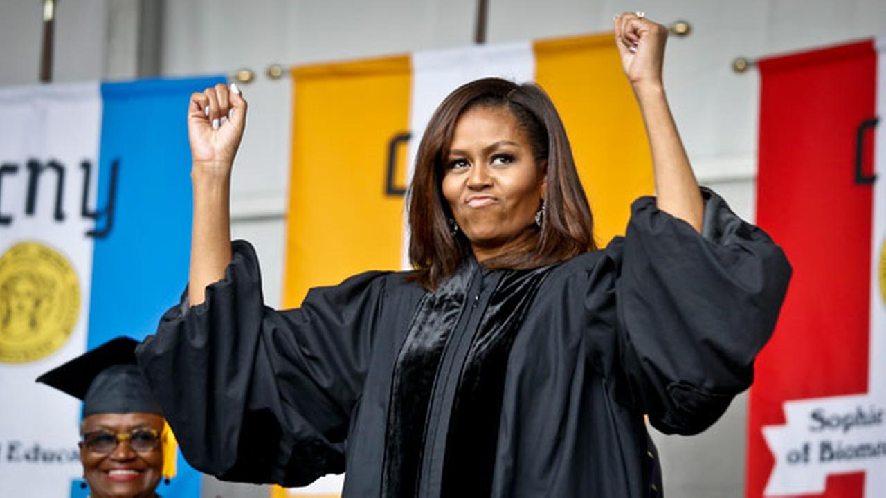 First lady Michelle Obama reacts to cheers from the class of 2016, during commencement for City College of New York, Friday June 3, 2016.