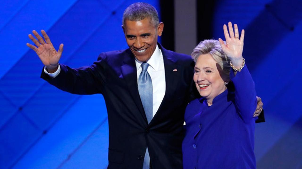 President Barack Obama and Democratic presidential nominee Hillary Clinton wave to delegates after President Obamas speech during the third day of the DNC in Philadelphia.