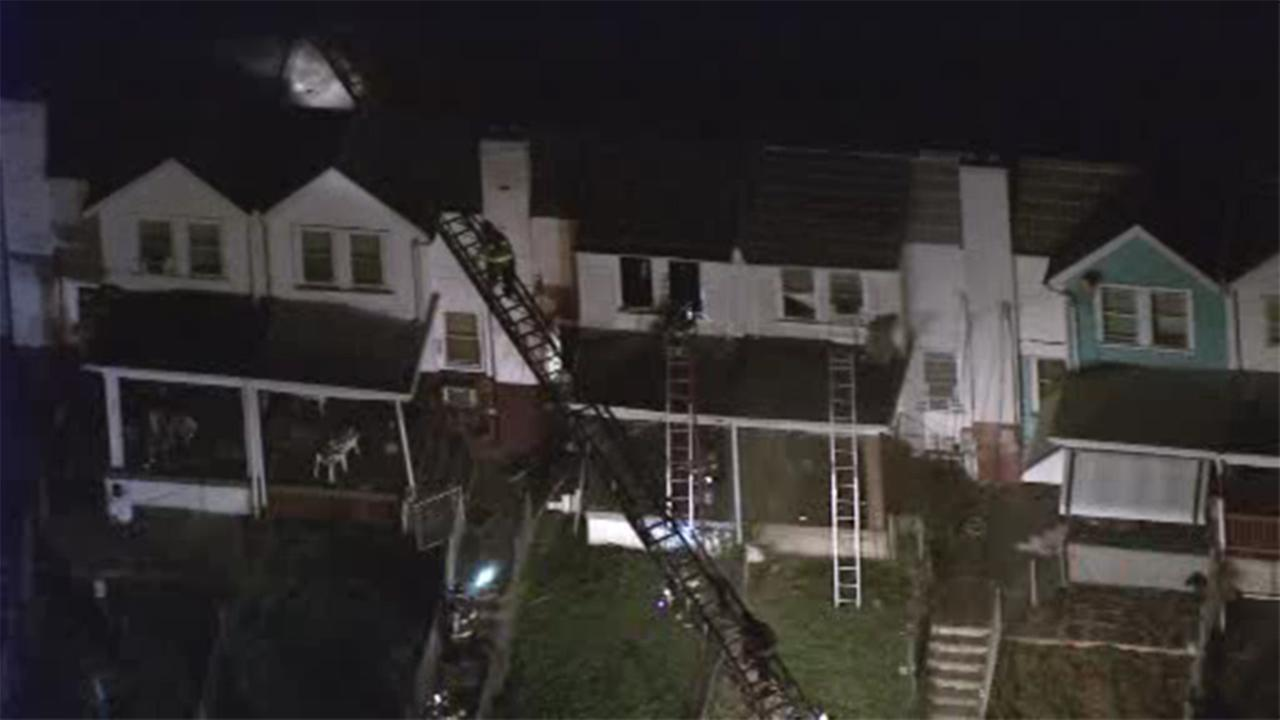 Firefighters battled a two-alarm house fire in Upper Darby, Pennsylvania.