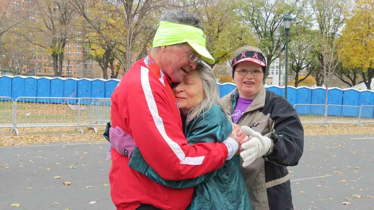 Don Wrights wife, Ardis, and daughter, Sarah, greet him at the finish of his 100th marathon.
