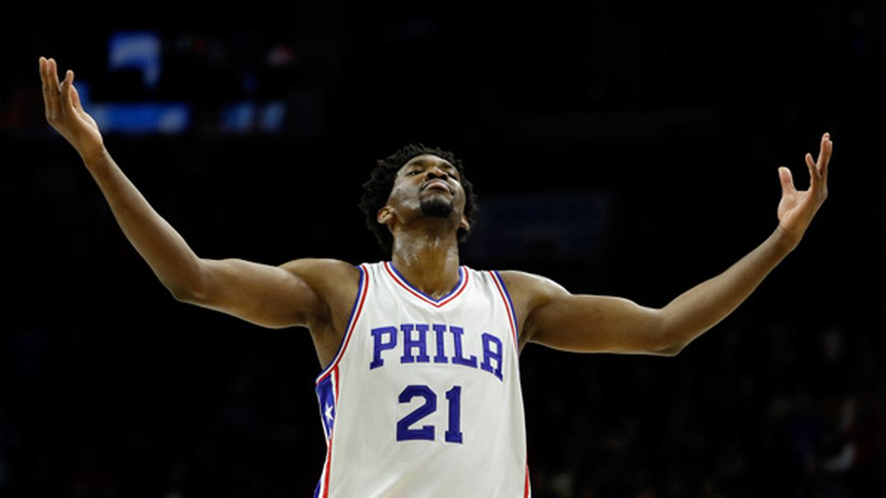 Philadelphia 76ers Joel Embiid reacts after a Miami Heat turnover late in the second half of an NBA basketball game, Monday, Nov. 21, 2016, in Philadelphia.