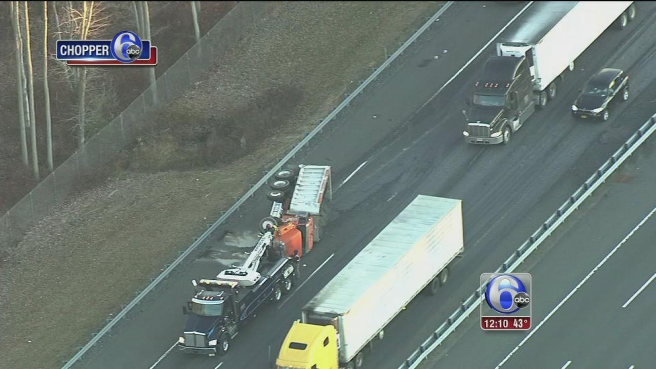 VIDEO: Dump truck overturns in NJ Tpk.