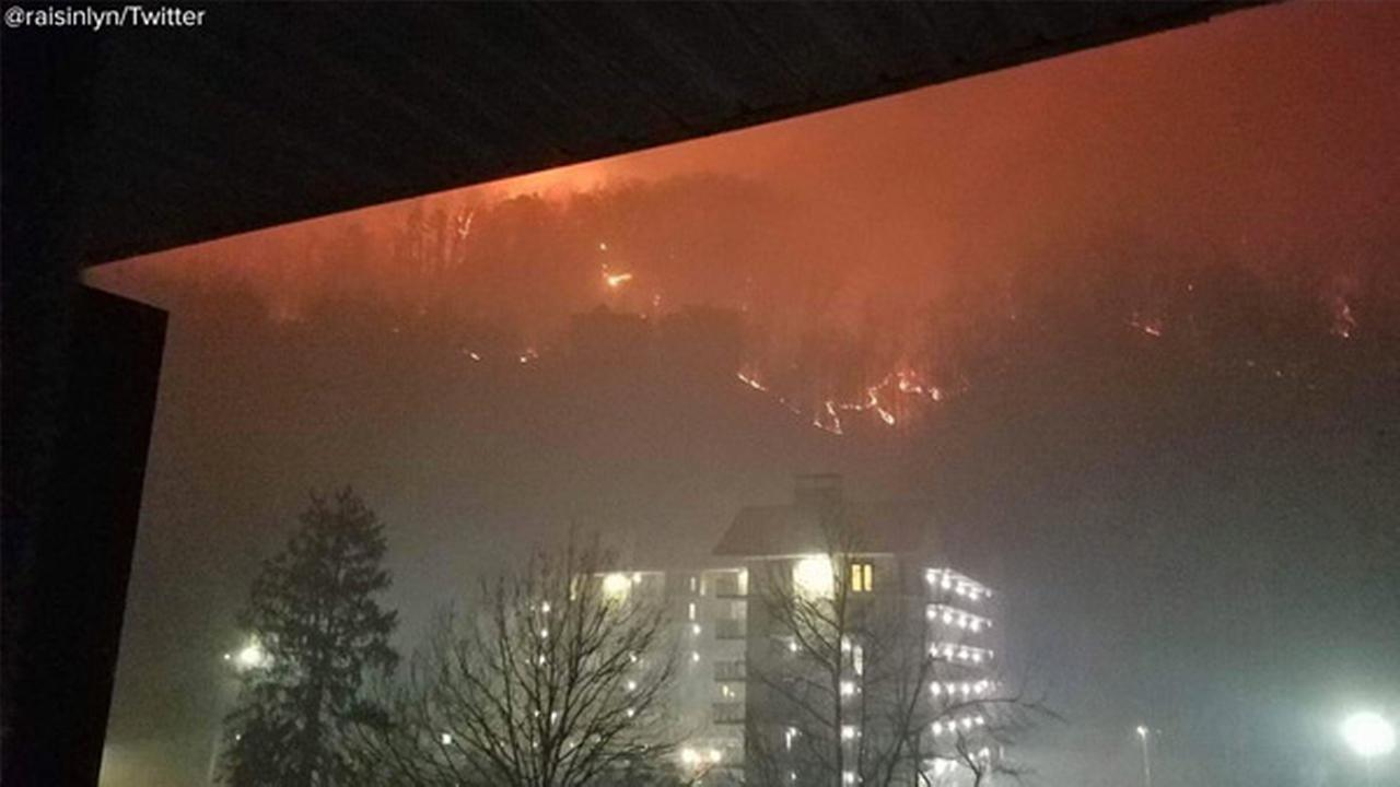 As Smokey Mountain towns ordered to evacuate, guest cabins at Dollywood also evacuated as wildfires rage nearby.