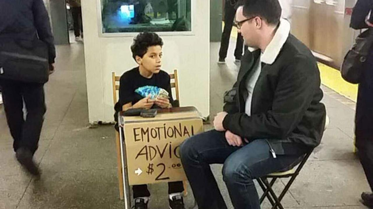 Boy, 11, offers New York subway riders 'emotional advice' for $2