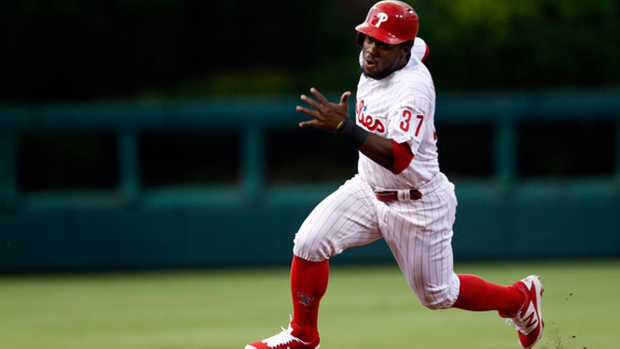 Philadelphia Phillies Odubel Herrera runs the bases to score on a double by Freddy Galvis on a pitch from St. Louis Cardinals Adam Wainwright.
