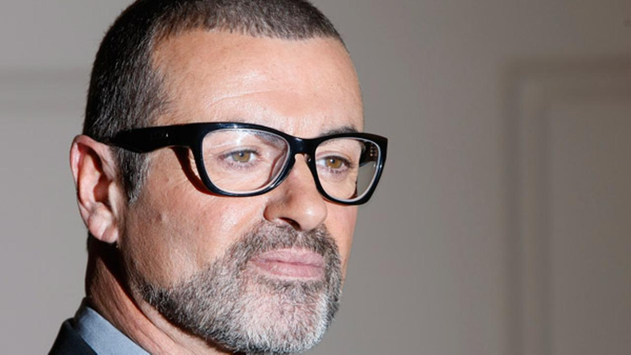 British singer George Michael poses for the cameras at an event to announce his European Orchestral tour in London.
