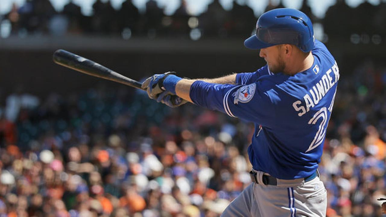 Toronto Blue Jays Michael Saunders hits a home run off San Francisco Giants relief pitcher Santiago Casilla in the ninth inning of their baseball game Wednesday, May 11, 2016.