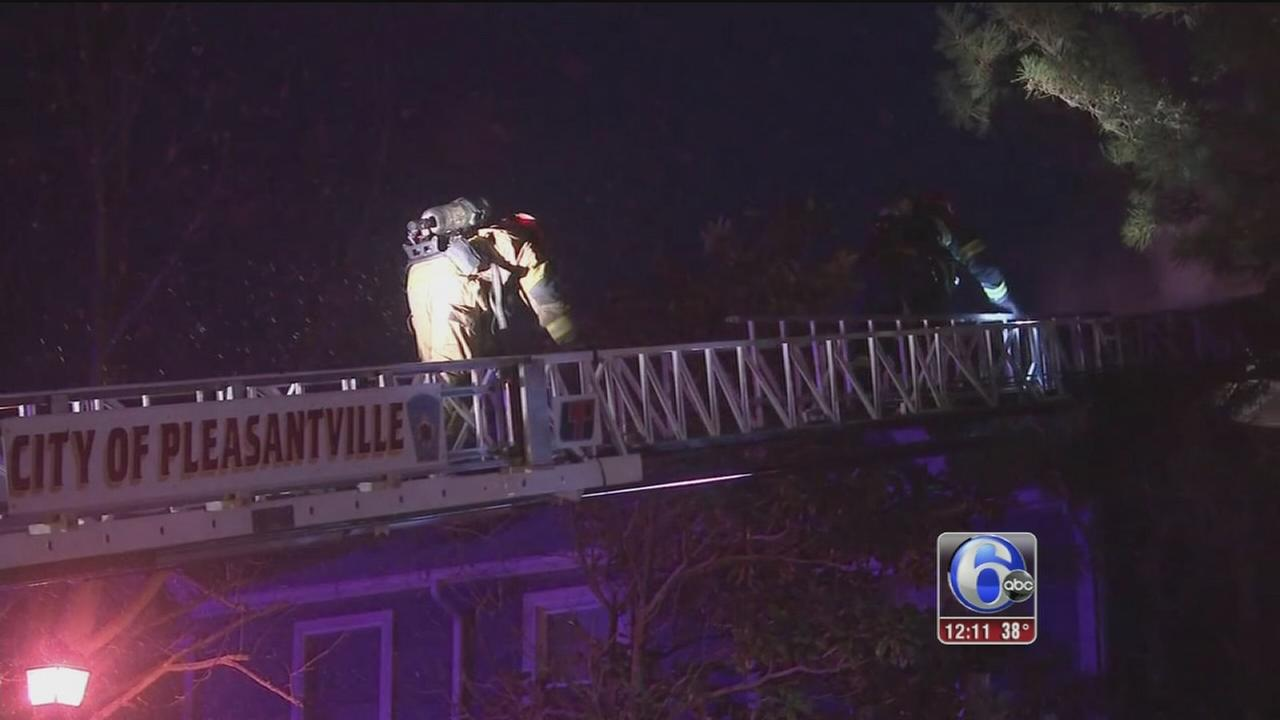 2 rescued from burning home in Pleasantville