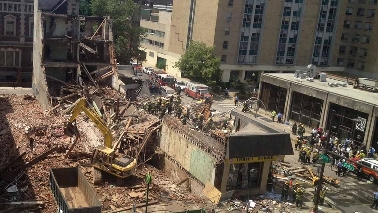 Emergency personnel respond to a building collapse in downtown Philadelphia, Wednesday, June 5, 2013. (AP Photo/Dino Hazell)