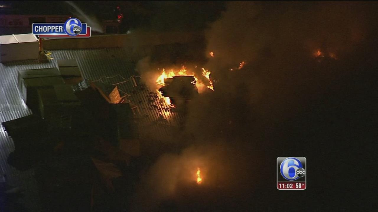 Firefighters battle building fire in Logan Township