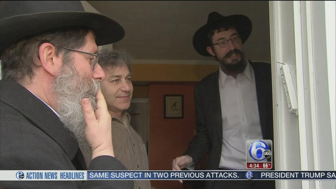 Rabbis install mezuzahs at local homes