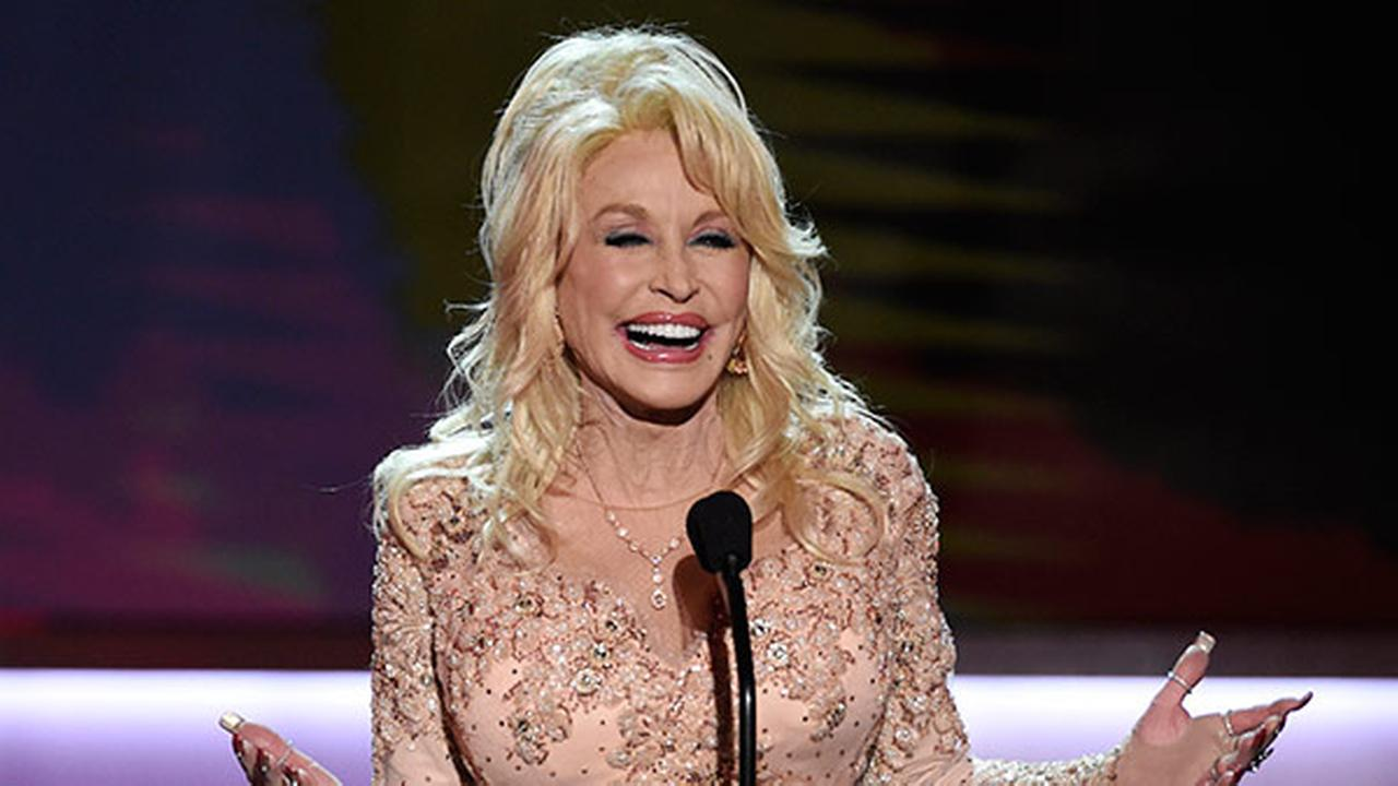 FILE - In this Jan. 29, 2017, file photo, Dolly Parton presents the Lifetime Achievement Award at the 23rd annual Screen Actors Guild Awards in Los Angeles.