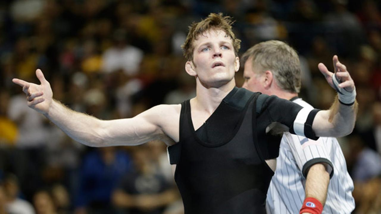 Iowas Cory Clark celebrates after defeating South Dakota States Seth Grossin a 133-pound match in the championship round of the NCAA Division I wresting championships.