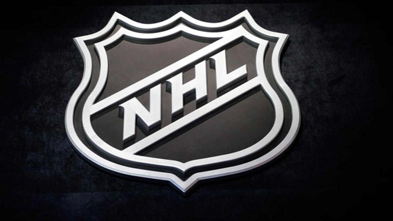 An NHL logo is shown before the start of the first round of the NHL hockey draft, Friday, June 26, 2015 in Sunrise, Fla.
