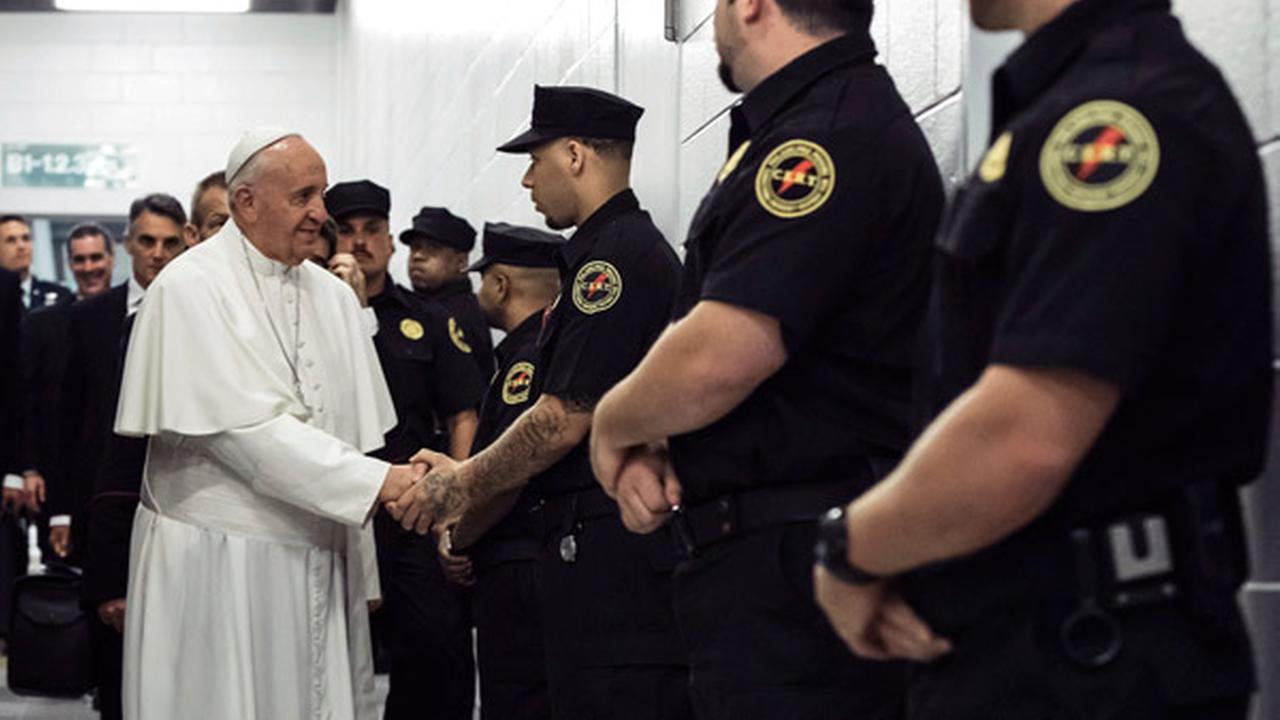 In a Sunday, Sept. 27, 2015 file photo, Pope Francis greets corrections officers at the Curran-Fromhold Correctional Facility in Philadelphia, during his visit there.