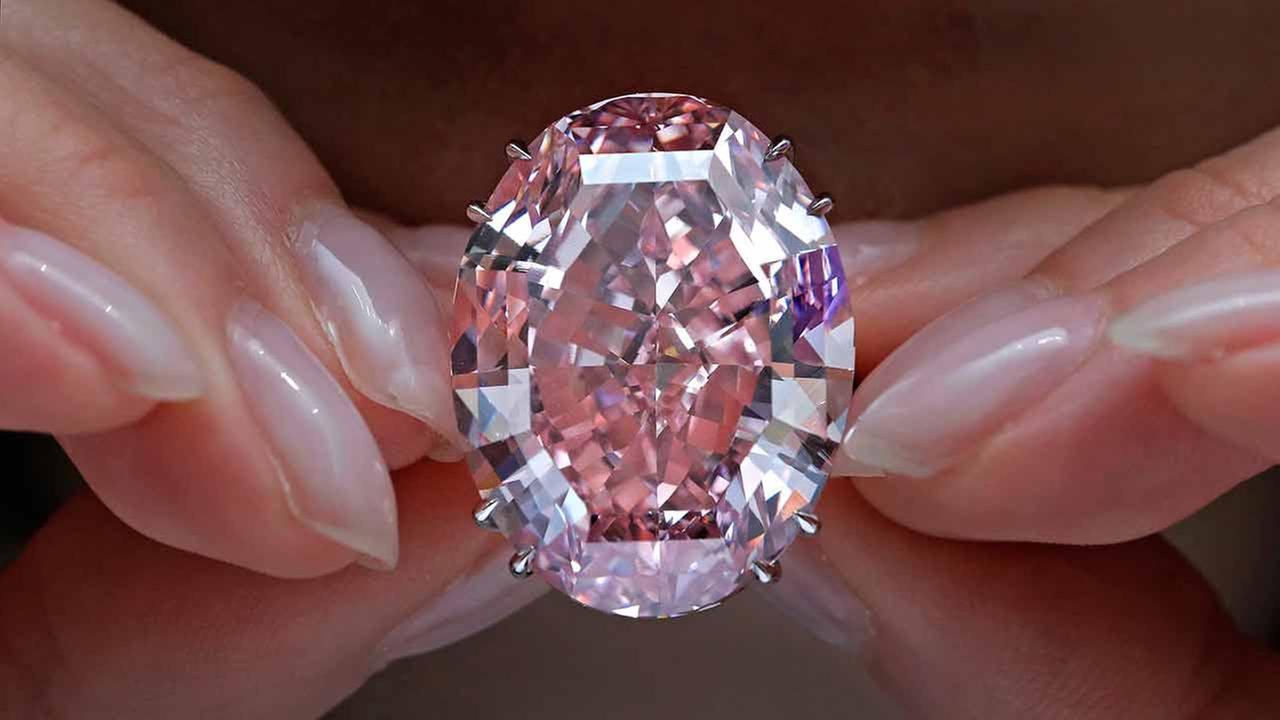 FILE - In this Wednesday, March 29, 2017, file photo, the Pink Star diamond is displayed by a model at a Sothebys auction room in Hong Kong.
