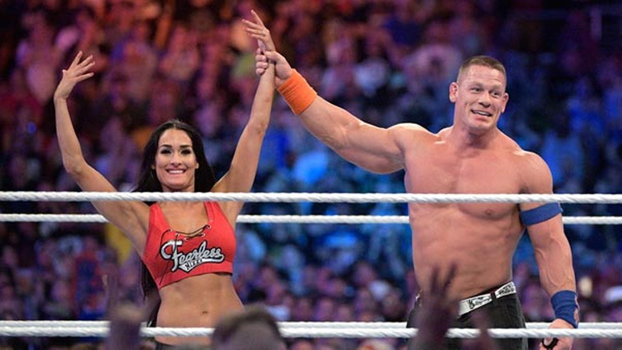 WWE Superstars John Cena, right, and Nikki Bella show off the engagement ring after she accepted his marriage proposal during WrestleMania 33 on Sunday, April 2, 2017, in Orlando,
